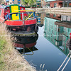Regent's Canal, London, colourful narrow boats moored.
