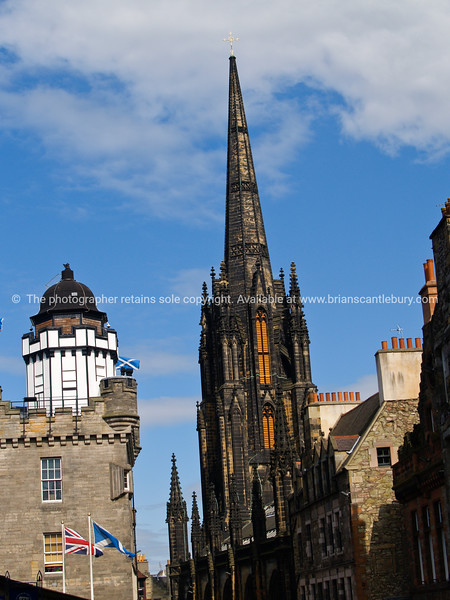 """Royal Mile architecture, Edinburgh,Scotland,flags,gothic,historic,tourism,buildings,place of interest,sky,steeple,spire, SEE ALSO:   <a href=""""http://www.blurb.com/b/893070-impressions-of-the-uk"""">http://www.blurb.com/b/893070-impressions-of-the-uk</a>"""