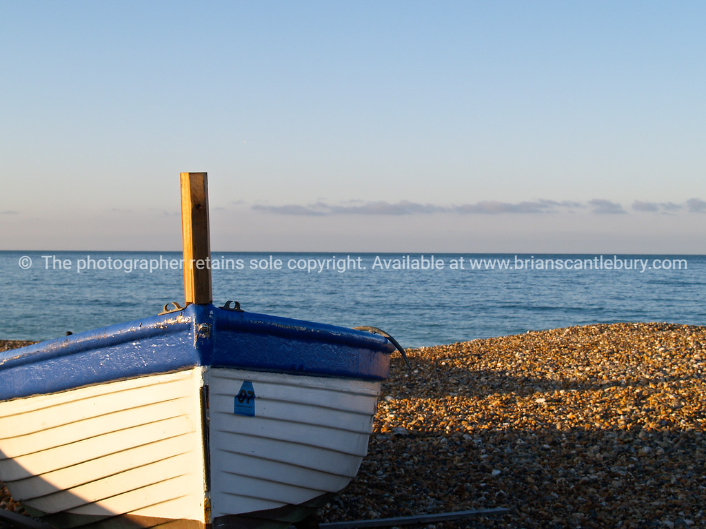 """Blue and white bow of Worthing fishing boat, on beach. SEE ALSO:   <a href=""""http://www.blurb.com/b/893070-impressions-of-the-uk"""">http://www.blurb.com/b/893070-impressions-of-the-uk</a>"""
