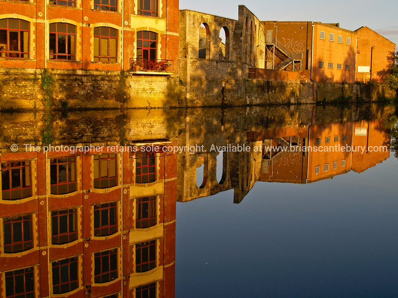 """Factory reflections in Avon River, Bath, England, UK. SEE ALSO:   <a href=""""http://www.blurb.com/b/893070-impressions-of-the-uk"""">http://www.blurb.com/b/893070-impressions-of-the-uk</a>"""