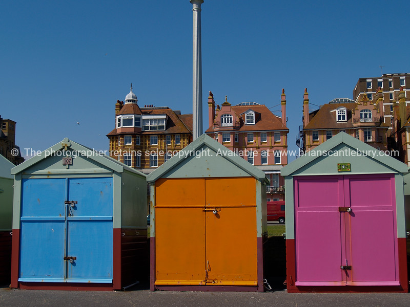 "Three Hove beach huts in foreground of traditional residetial architecture of the area, England, Britian, United Kingdom. SEE ALSO:   <a href=""http://www.blurb.com/b/893070-impressions-of-the-uk"">http://www.blurb.com/b/893070-impressions-of-the-uk</a>"