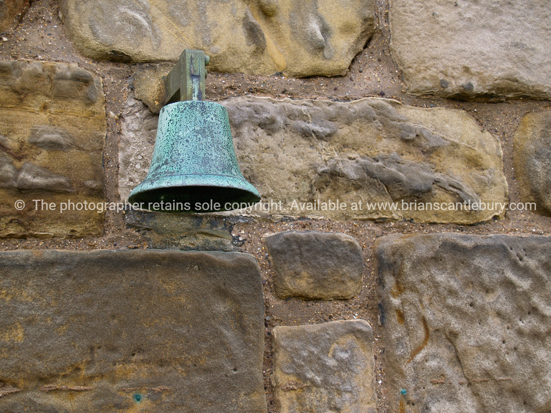 """Old stone wall, with green brass ball, close-up. SEE ALSO:   <a href=""""http://www.blurb.com/b/893070-impressions-of-the-uk"""">http://www.blurb.com/b/893070-impressions-of-the-uk</a>"""
