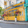 Typiical English street architecture in bright yellow and turquoise