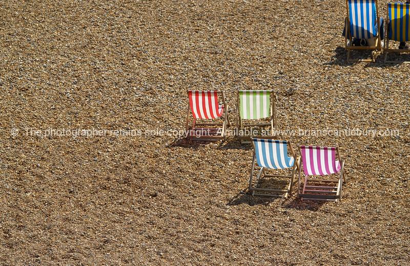 "Dechchairs grouped on beach, Brighton, England, Britain, United Kingdom. SEE ALSO:   <a href=""http://www.blurb.com/b/893070-impressions-of-the-uk"">http://www.blurb.com/b/893070-impressions-of-the-uk</a>"