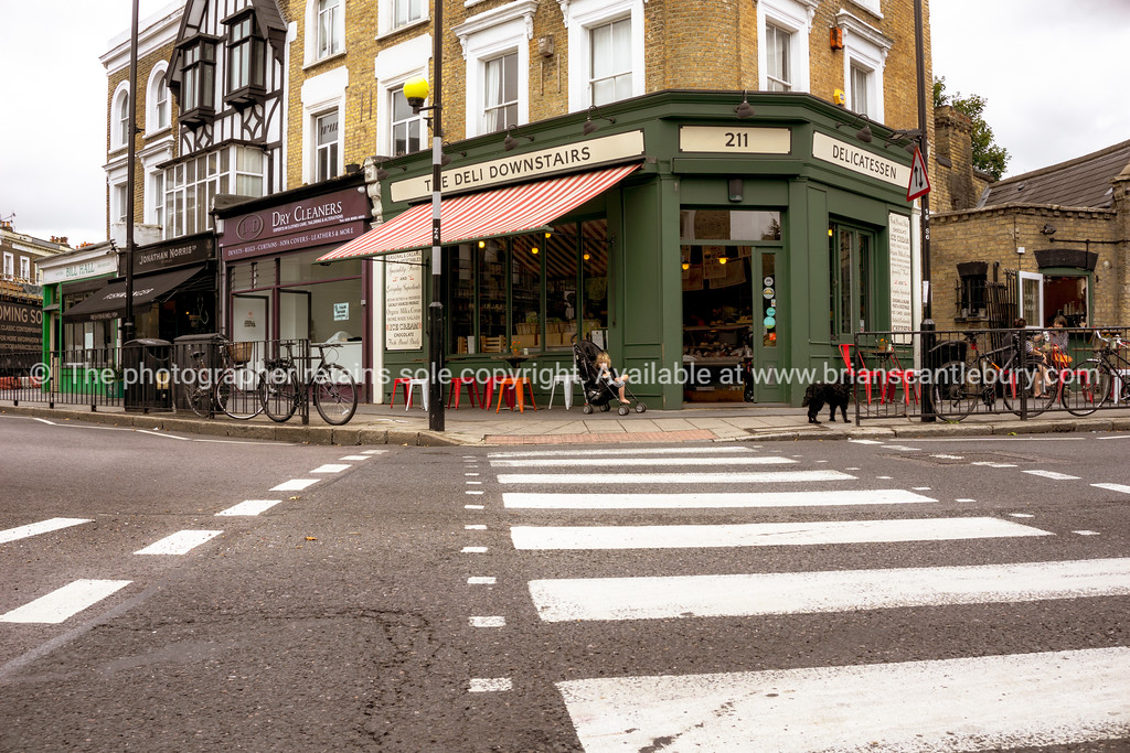London, street scenes Bow, pedestrian crossing to deli across intersection.