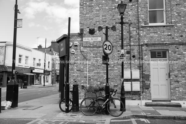 Lyal Road corner, brick building and street sign.