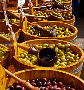 Olives by the barrell, in markets, England, Britain, United Kingdom. Columbia Road Flower Market SEE ALSO:  www.blurb.com/b/893070-impressions-of-the-uk
