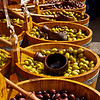 """Olives by the barrell, in markets, England, Britain, United Kingdom. Columbia Road Flower Market SEE ALSO:   <a href=""""http://www.blurb.com/b/893070-impressions-of-the-uk"""">http://www.blurb.com/b/893070-impressions-of-the-uk</a>"""
