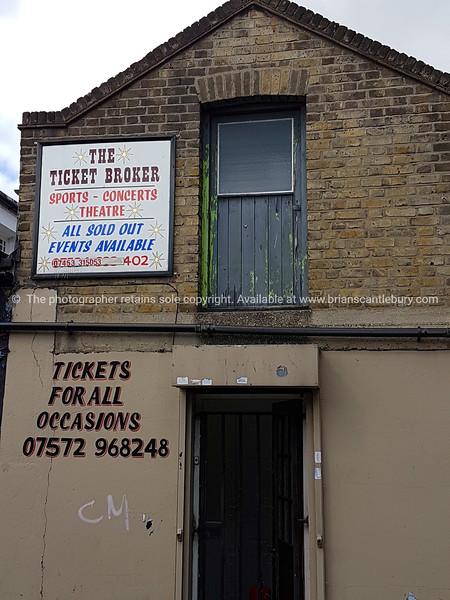 The Ticket Broker sign