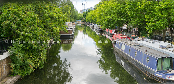 Narrow boats and canal activity along London's Regent Canal.