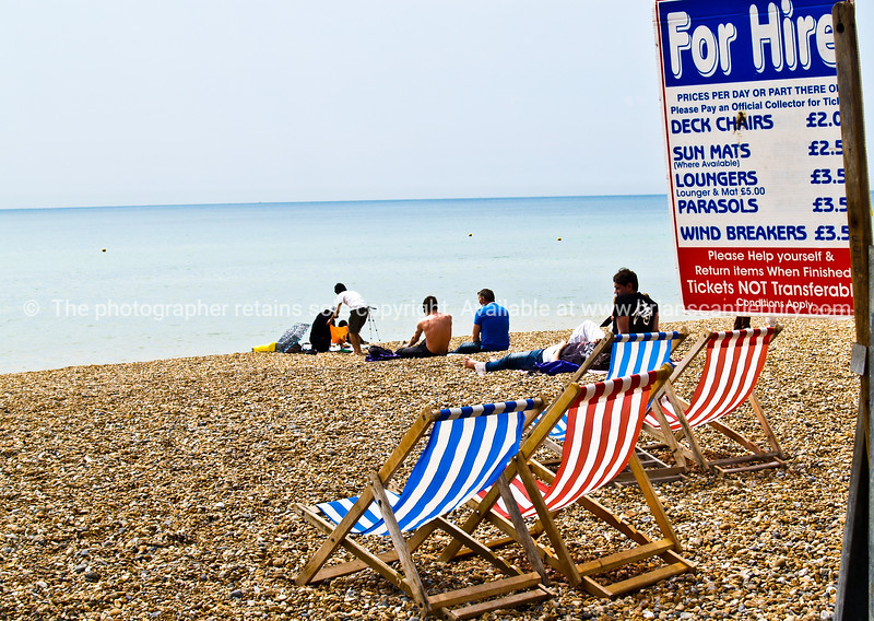 "Brighton,England, typical beach scene with deckchairs for hire. Britain, United Kingdom. SEE ALSO:   <a href=""http://www.blurb.com/b/893070-impressions-of-the-uk"">http://www.blurb.com/b/893070-impressions-of-the-uk</a>"