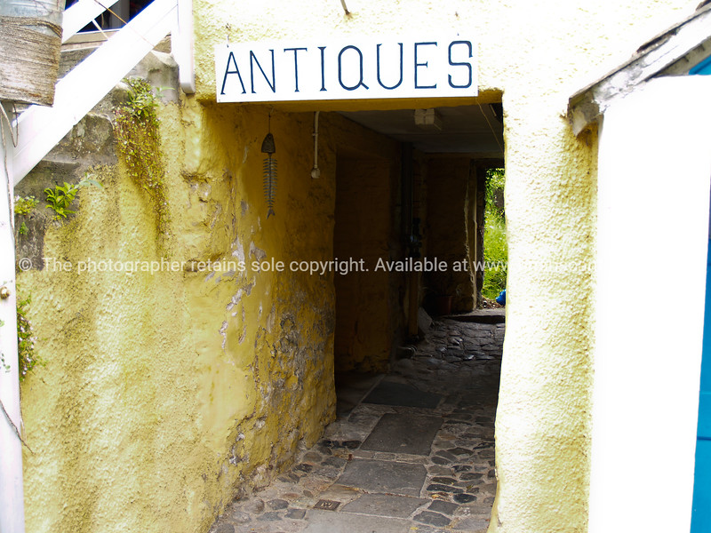"""Antiques, rustic sign marking entrance. SEE ALSO:   <a href=""""http://www.blurb.com/b/893070-impressions-of-the-uk"""">http://www.blurb.com/b/893070-impressions-of-the-uk</a>"""