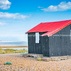 Famous black shed with red roof on Rye Nature Reserve.
