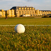 """Golf ball close-up on fairway with St. Andrews Hotel in Background. SEE ALSO:   <a href=""""http://www.blurb.com/b/893070-impressions-of-the-uk"""">http://www.blurb.com/b/893070-impressions-of-the-uk</a>"""