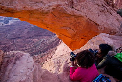 Living life on the edge...there I was laying flat on my belly, camera in hand-no starps capturing the sunrise at the Mesa Arch.  I can't imagine what I was thinking.  My friend David Timms took this image.