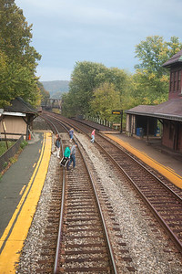 Travellers crossing the train track after the train departed the station at Harper's Ferry