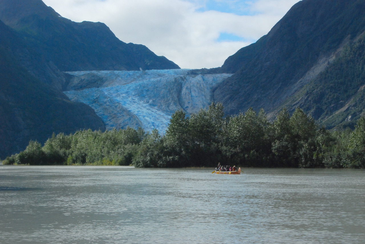 A canoe bringing the rest of our party down the river from the Davidson Glacier.