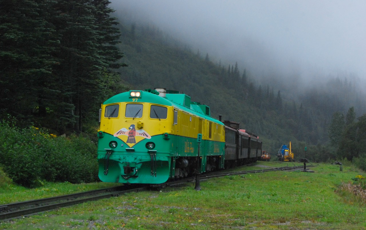 Waiting for the train at the end of our Laughton Glacier hike. A good old SE Alaska rain is falling.