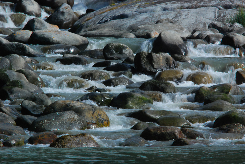 Where the fresh water meets the sea - a small rapid at the base of a waterfall.