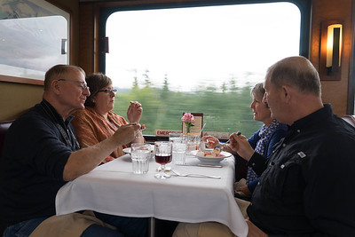 the Parkers and Burtons enjoy a berry dessert aboard the Wilderness Express