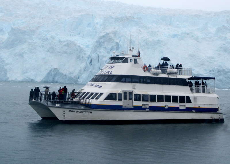 A tour boat sits before Aialik Glacier - Kenai Fjords National Park.