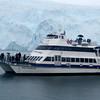 A tour boat sits before Aialik Glacier - Kenai Fjords National Park.