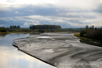 "Glacial silt forms a ""silt bar"" in the river.  Taken from the Wilderness Express Train from Anchorage to Talkeetna."