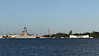 USS Missouri and the USS Arizona Memorial.  The red and white tower is the old control tower for the airfield.