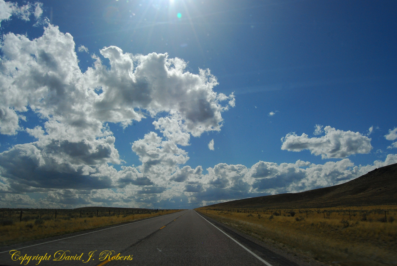 Endless road and sky across southern Idaho