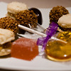 Petit fours: macarons, butterscotch lollipop, lychee jelly, truffles, and chocolate drop.<br /> <br /> Cyrus