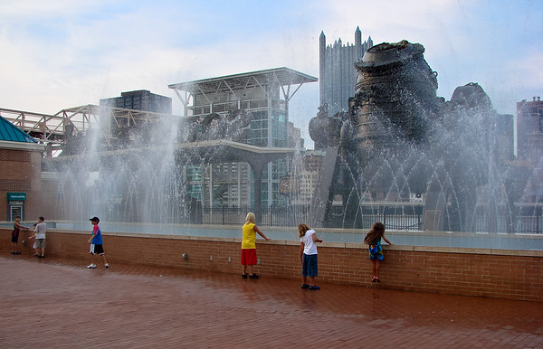 Children enjoying the fountain.