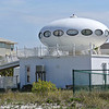"UFO lands on house at Pensacola Beach. I love the ""aliens"" in the window."