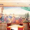 Mural in restaurant at Penn's View Hotel. note the man on the right with two aces behind his back.