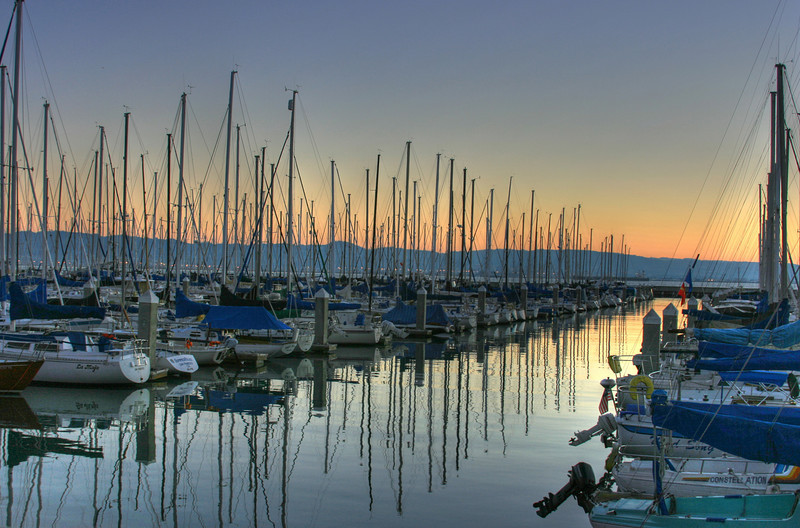 sailboats at sunrise