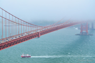 San Francisco, California (USA) - June 10: Closeup view of Golden Gate Bridge from Marin Headlands with a boat passing underneath in San Francisco, California (USA) on June 10, 2013