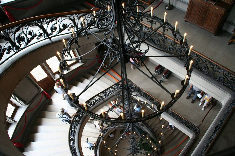 The grand staircase with a chandelier 4 stories tall.<br /> The place was wired for both AC and DC current because the standard was not yet set. He also had generators on site.