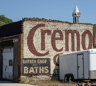 Creative business: barber and bath...good times under the watchful eye of the town church
