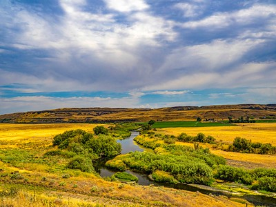 Small river meandering through farms and countryside