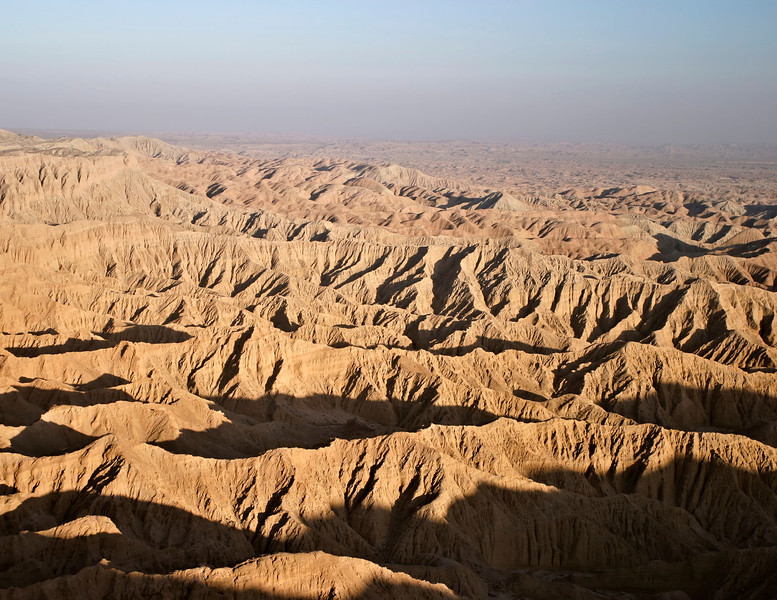 A view of the badlands in the Anza-Borrego desert from the top of Font's Point. The rocks are have a sort of warm glow from the sunset.