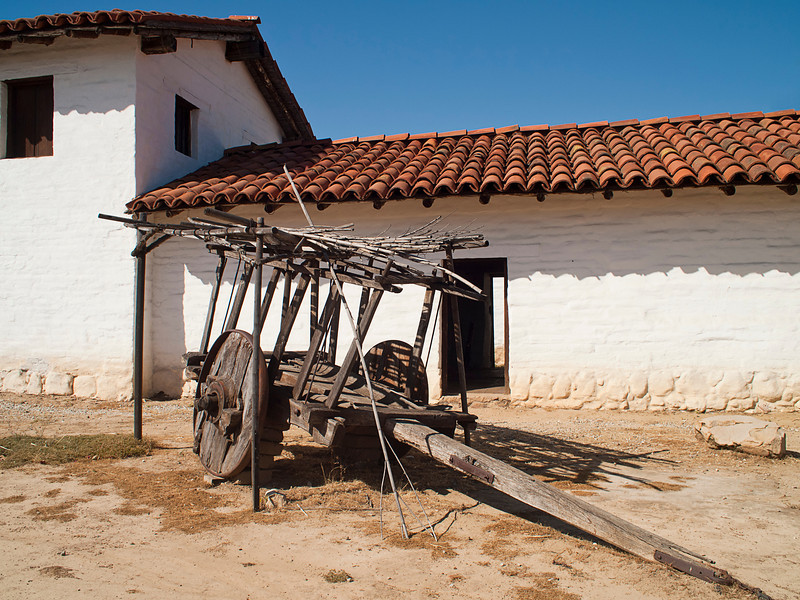 An old wood wagon in the courtyard of one of the old Santa Barbara mission buildings.
