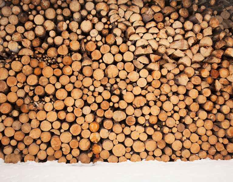 An enormous stack of firewood that has been cut, split and dried for use.