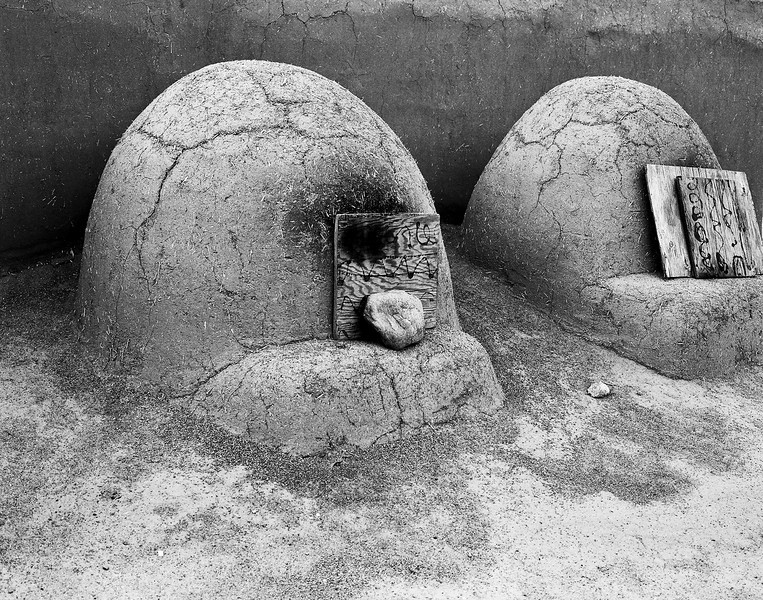 Two hornos ovens in New Mexico Pueblo. Hornos ovens are traditional dome-shaped outdoor ovens used by native Americans in the American Southwest region. (Scanned from black and white film.)