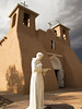 A marble statue of St. Francis in contemplation stands in front of the San Francisco de Asis Mission Church in Rancho de Taos in New Mexico.