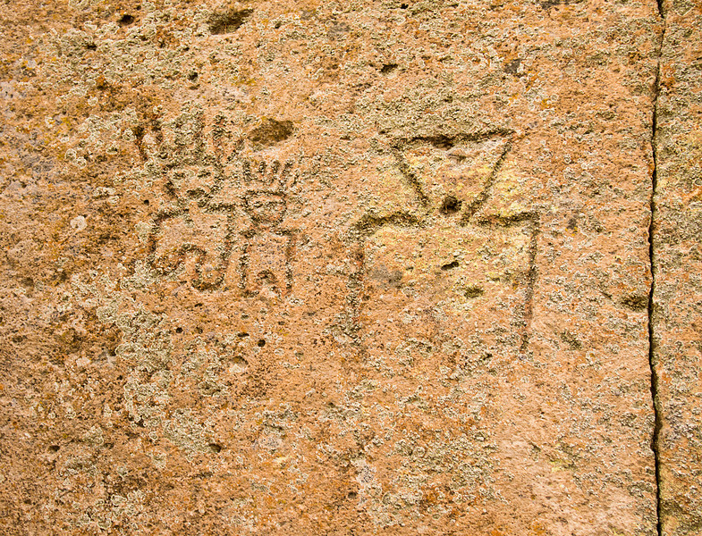 These petroglyphs were carved by native Americans into stone cliffs near Tsankawi in the Bandelier National Monument area of new Mexico.