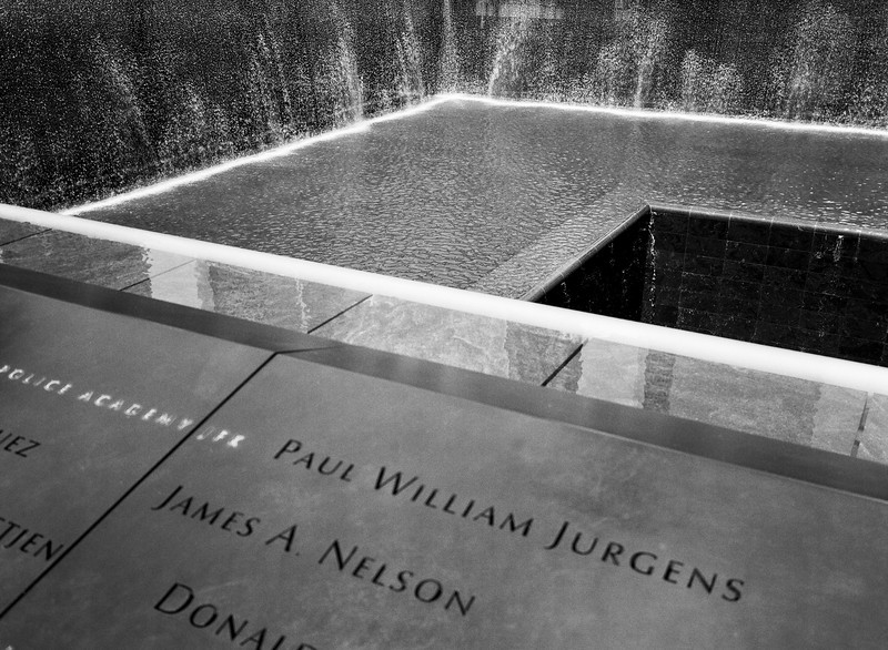 NEW YORK, NY - June 24, 2012:  A view of the memorial and the fountain at the 9/11 Memorial to the World Trade Center in New York City on June 24, 2012. (Scanned from black and white film.)