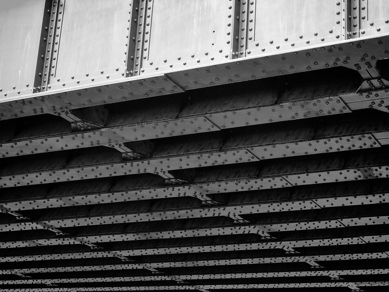 A view of the steel beams supporting a bridge under the High Line Park in Manhattan in New York City.