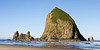 Haystack Rock, on Cannon Beach, Oregon is one of the largest sea stacks on the west coast of the United States. At over 200 feet tall, this monolith dwarfs the beach and is a landmark for tourists.