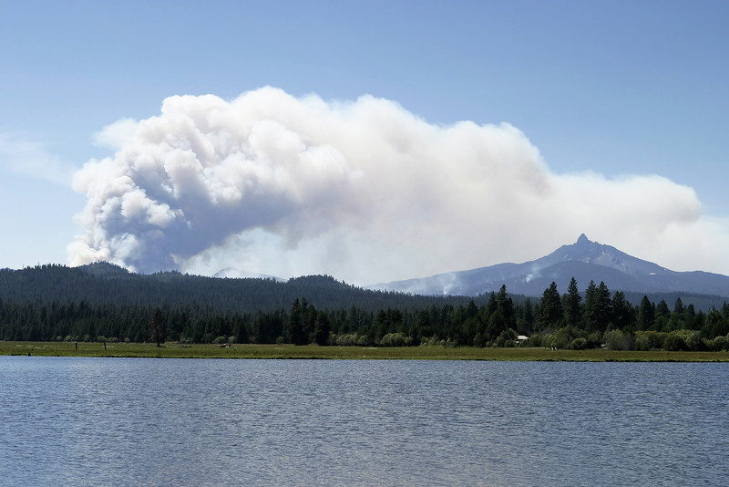 A cloud of smoke rises from the Lake George forest fire in Central Oregon in 2006.  The plume of smoke is rising over Mt. Washington in the Oregon Cascades.