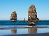 Two large sea stacks on Cannon Beach in Oregon State. These two weather-beaten rocks are located near Haystack Rock.