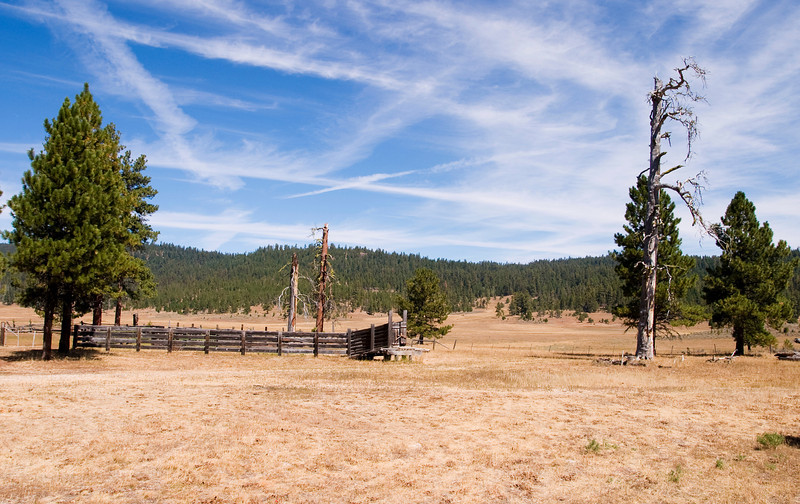 An old wooden corral on Gray Prairie in Central Oregon. The corral is used with cows that graze on the prairie grass.
